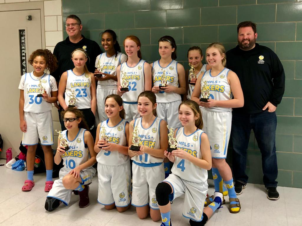 Girls 7th Grade Gold pose with their hardware after taking 2nd Place at Roseville Holiday Classic