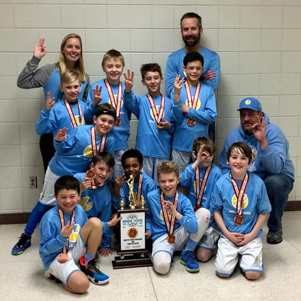 Minneapolis Lakers Boys 4th Grade Gold pose with their Medals & team trophy after taking 3rd place at the MYAS Grade State year end tournament