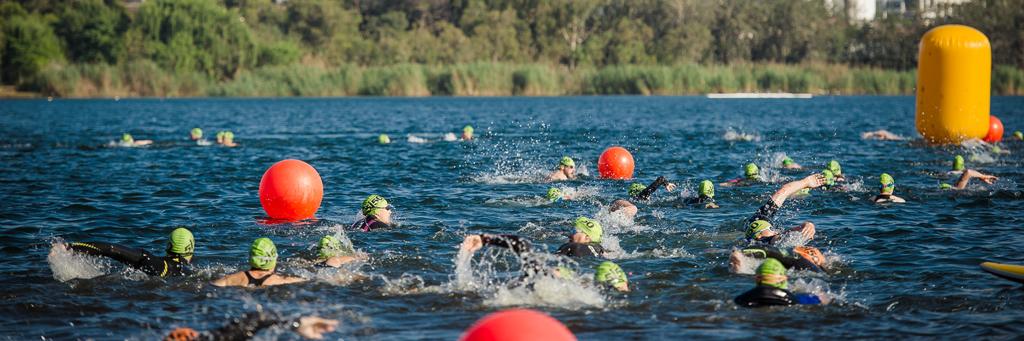 Athletes are swimming in blue waters of Germiston lake at 5150 Ekurhuleni in Gauteng