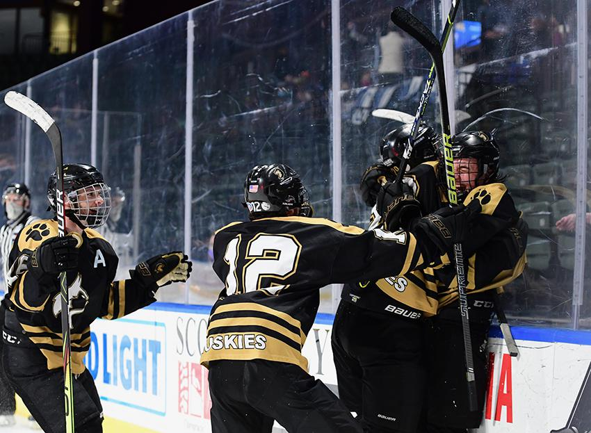 Players from Battle Mountain celebrate one of their five goals during their team's victory over Crested Butte in Loveland to win the first Class 4A state championship for ice hockey. Photo by Steven Robinson, SportsEngine