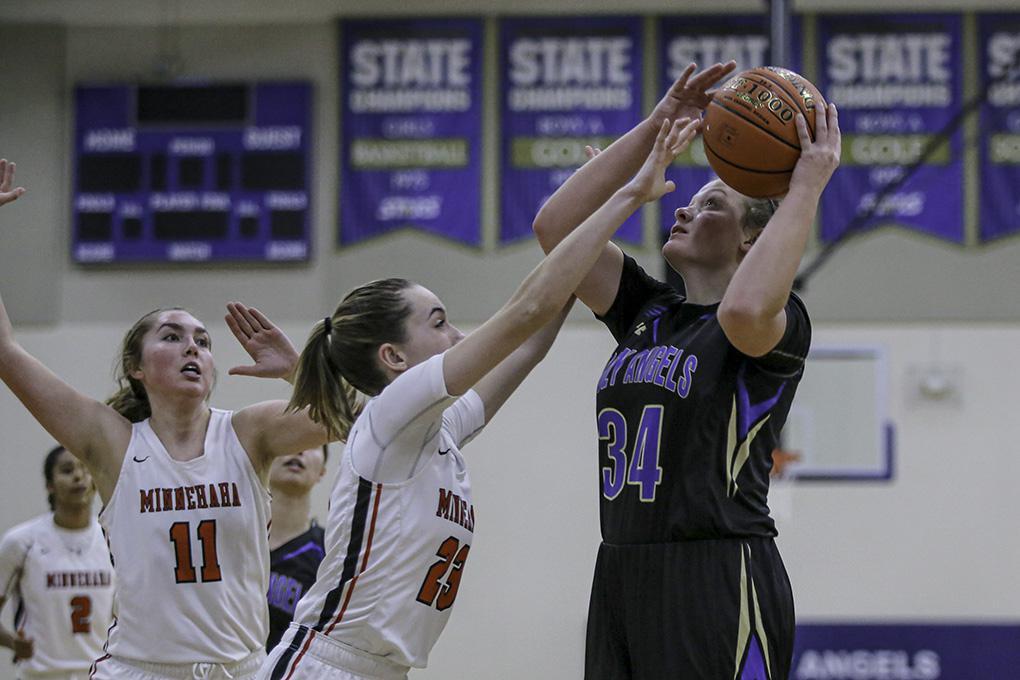 Rachel Kawiecki (34) got her shot off against Minnehaha Academy's Kate Pryor (23). Kawiecki had 17 points and nine rebounds for Holy Angels. Photo by Mark Hvidsten, SportsEngine