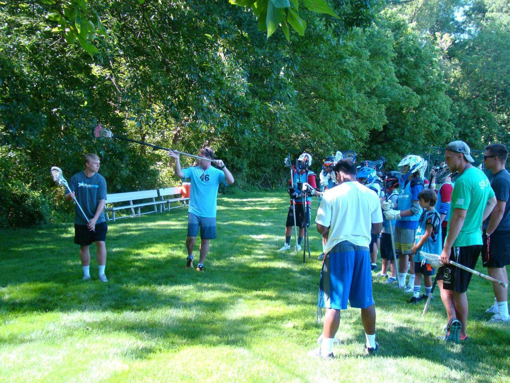 Coach MV Whitlow teaching the lost art of the takeaway check at Blue Star Lacrosse Overnight Camp