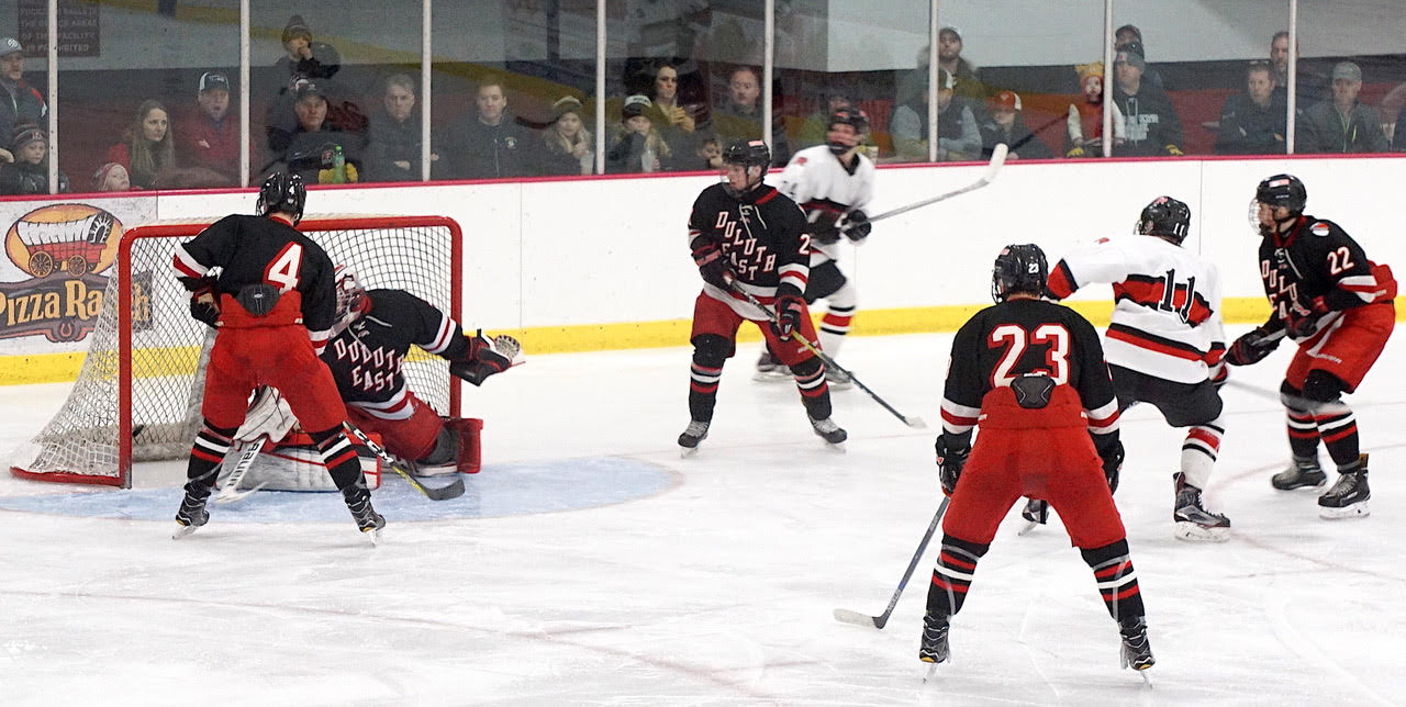 Elk River's Benton Maas (11) scores in the Elks' 4-1 win over Section 7-AA rival Duluth East on Saturday afternoon. Credit: Peter Odney.