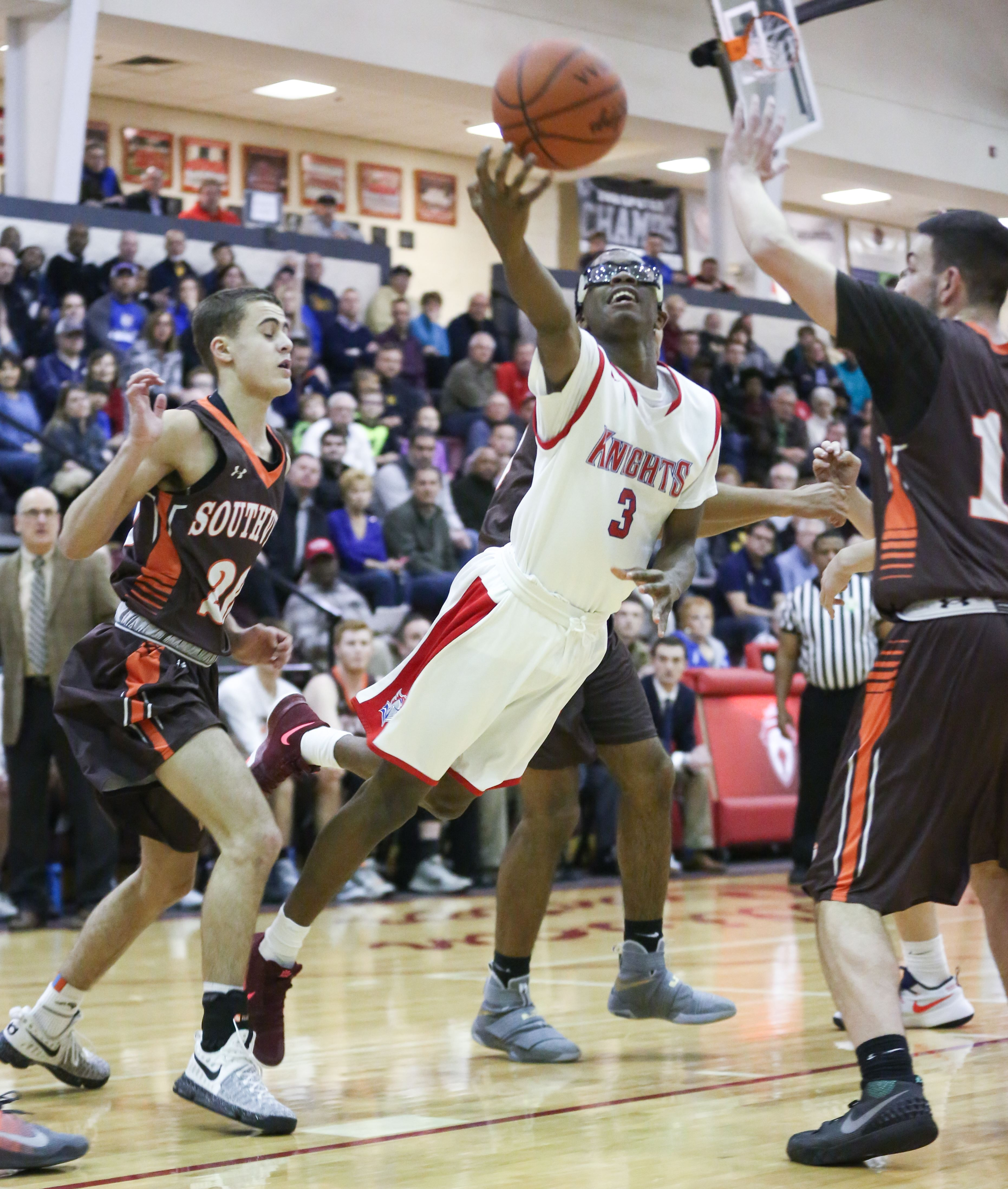 in pictures st francis 70 southview 67 st francis player jakiel wells shoots against southview s tyson king left and will wooddall the blade jeremy wadsworth