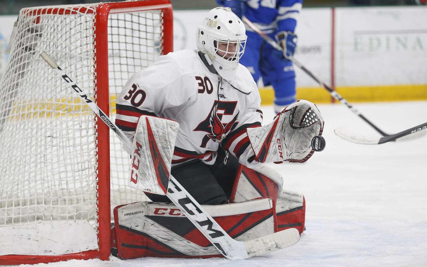 Eden Prairie's Axel Rosenlund (30) makes a glove save late in the third period against Minnetonka. Rosenlund had 24 saves in the Eagles' 6-1 victory over the Skippers. Photo by Jeff Lawler, SportsEngine