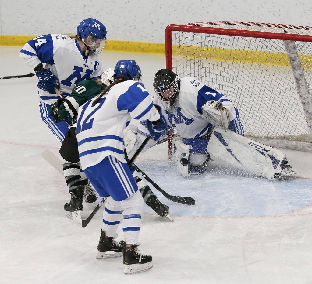 Minnetonka goalie Brynn Dulac (1) stops Anika Stoskopf's (10) shot from the top of the crease. Dulac is perfect through the first three games of the season, with the Skippers outscoring their opponents 23-0. Photo by Cheryl A. Myers, SportsEngine