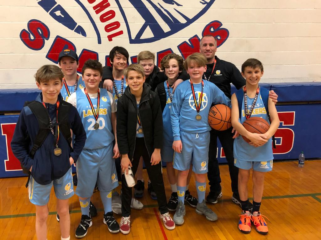 Mpls Lakers Youth Traveling Basketball Program Inc Boys 7th Grade White pose with their Medals after placing 2nd at the Inver Grove Heights tournament in Inver Grove Heights, MN