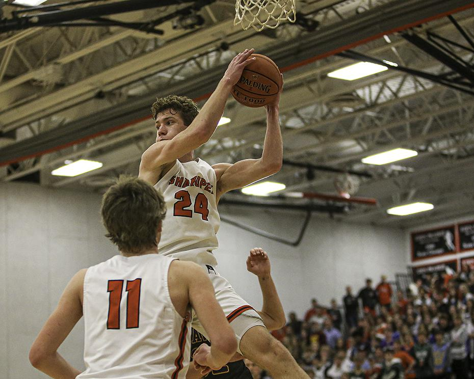Senior Charlie Katona (24) came down with one of his 15 rebounds in the second half of Shakopee's 61-50 victory over Chaska. He also scored 19 points. Photo by Mark Hvidsten, SportsEngine