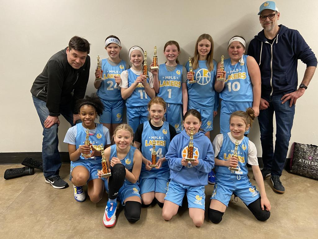 Mpls Lakers Youth Traveling Basketball Program Inc Girls 5th Grade Gold pose with trophies after earning 3rd place at the White Bear Girls Classic tournament in White Bear Lake, MN