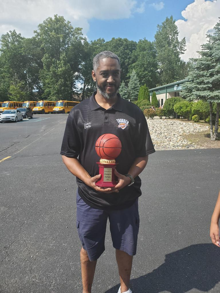 Coach Chris holding the 1st Place Trophy