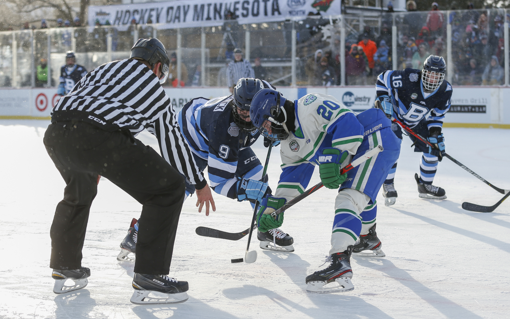 Blake's Joe Miller (20) faces off against Blaine's Zach Buzick (9) during the afternoon game of Hockey Day Minnesota. Miller scored the game-winner for the Bears in their 3-2 victory over the Bengals. Photo by Jeff Lawler, SportsEngine