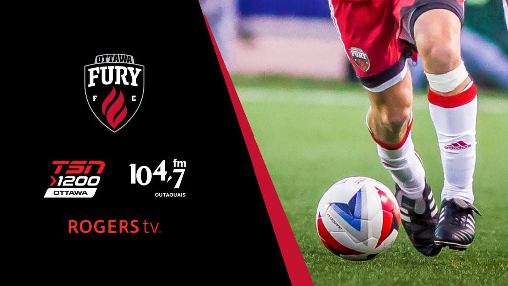 Fury FC player jostling with Fury FC Crest, Rogers TV logo and 104 logo.