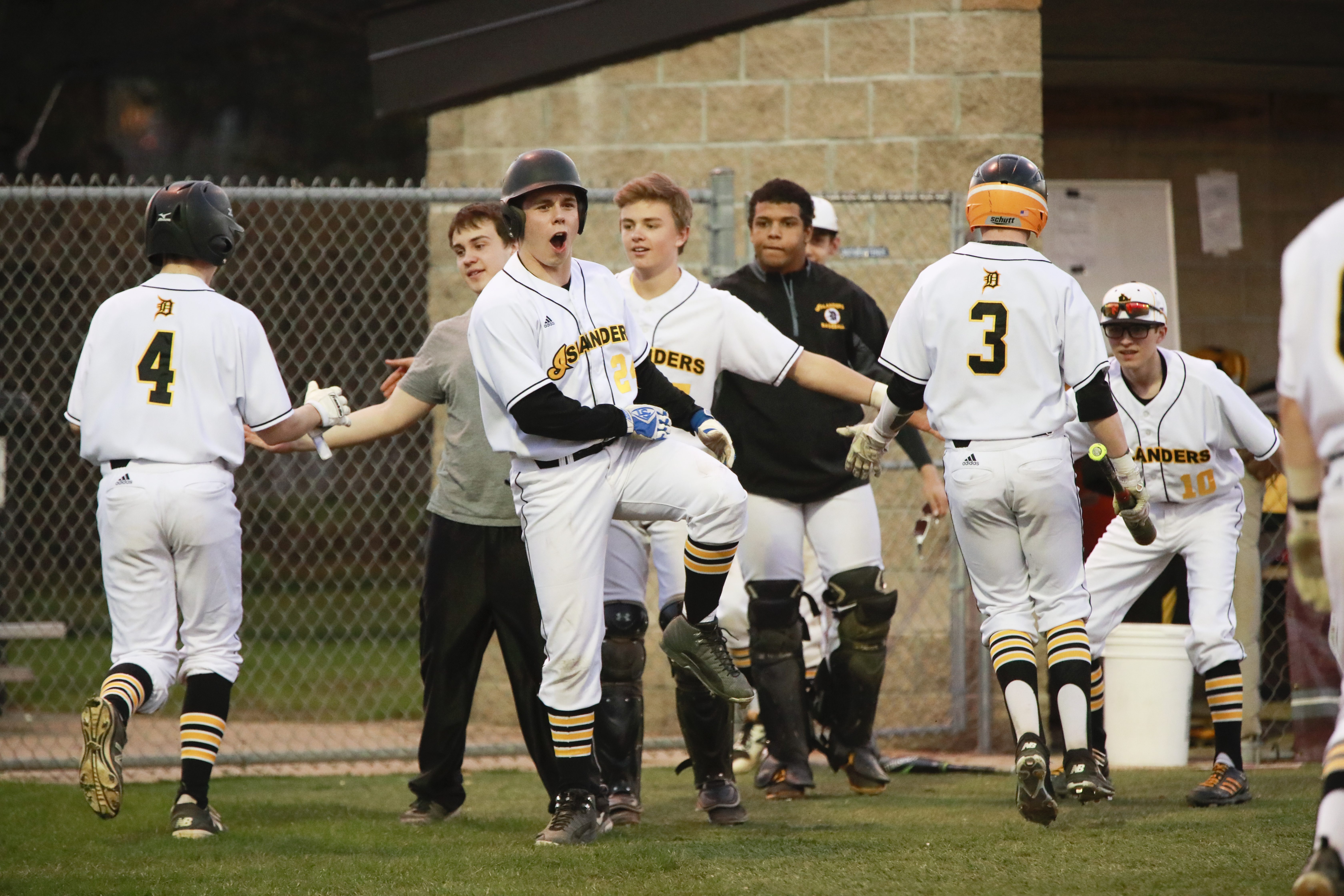 Apr 21, Paradise Field - DeLaSalle High School cheer as Joe Parenteau (3), Sam Kulesa (4), and  Gavin Taylor (24) scored runs in a game that ended in a 10-5 victory over Fridley High School. Photos by Chris Juhn/Sports Engine