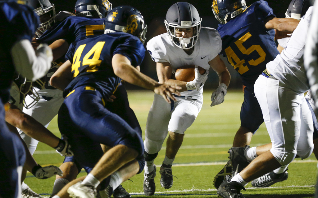 St. Thomas Academy running back Danny McFadden slips through the line on a 5-yd TD run early in the third quarter against Mahtomedi. McFadden had two rushing TDs in the Cadets' 38-0 victory over the Zephyrs Friday night. Photo by Jeff Lawler, SportsEngine