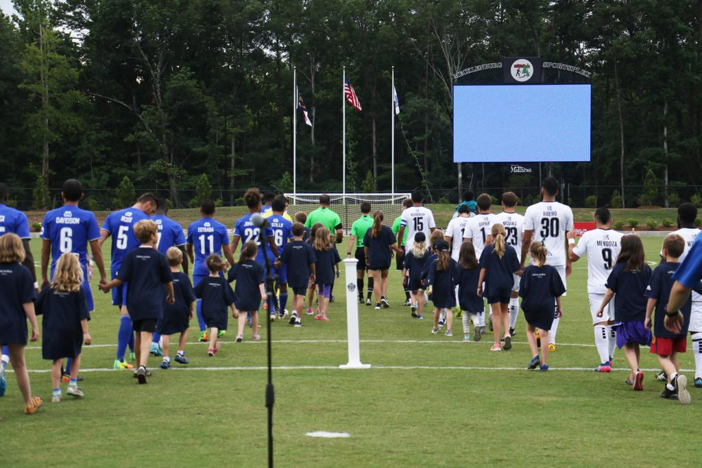 Charlotte Independence and Harrisburg City Islanders players walking onto the field