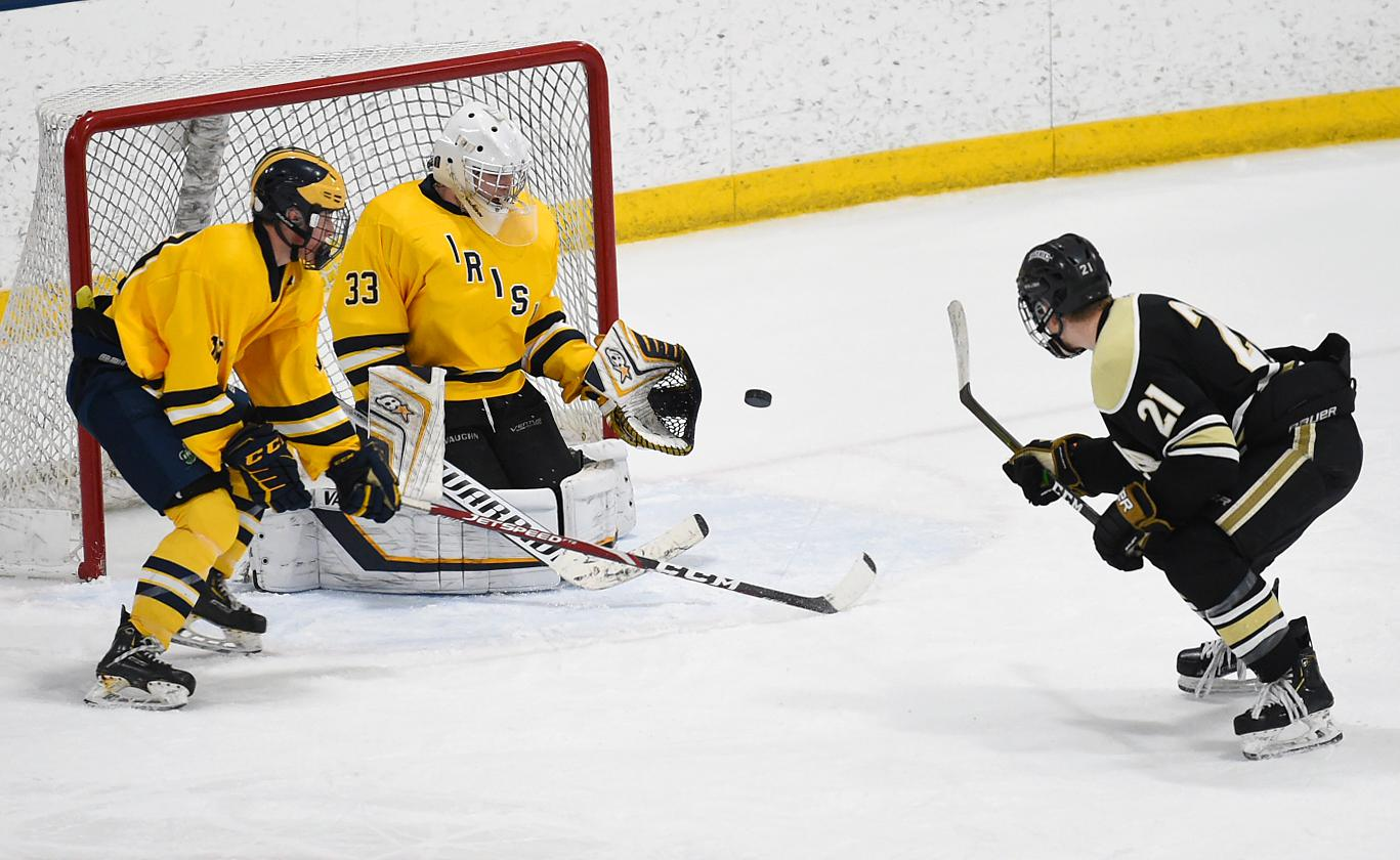 Andover's Harrison VanderMey fires the puck past Rosemount goalie Will Tollefson for the winning goal in Thursday's matchup at the St. Louis Park Rec Center. Photo by Loren Nelson, LegacyHockeyPhotography.com