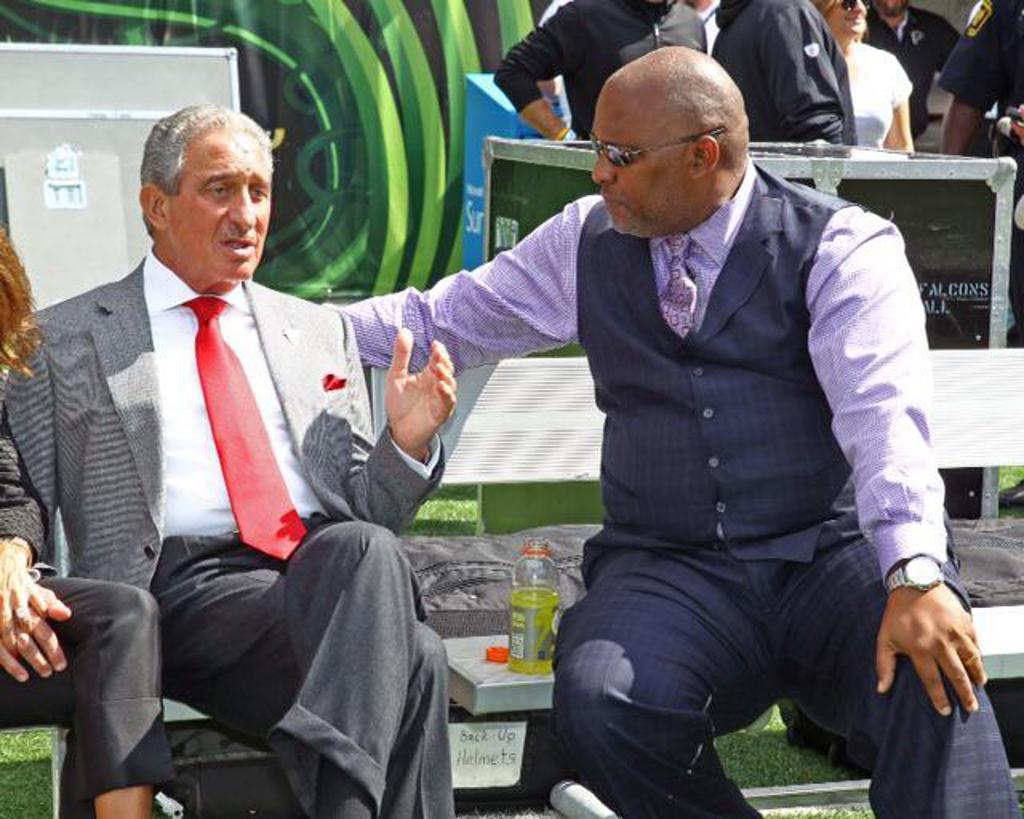 Reggie Roberts, right, with Atlanta Falcons owner Arthur Blank.