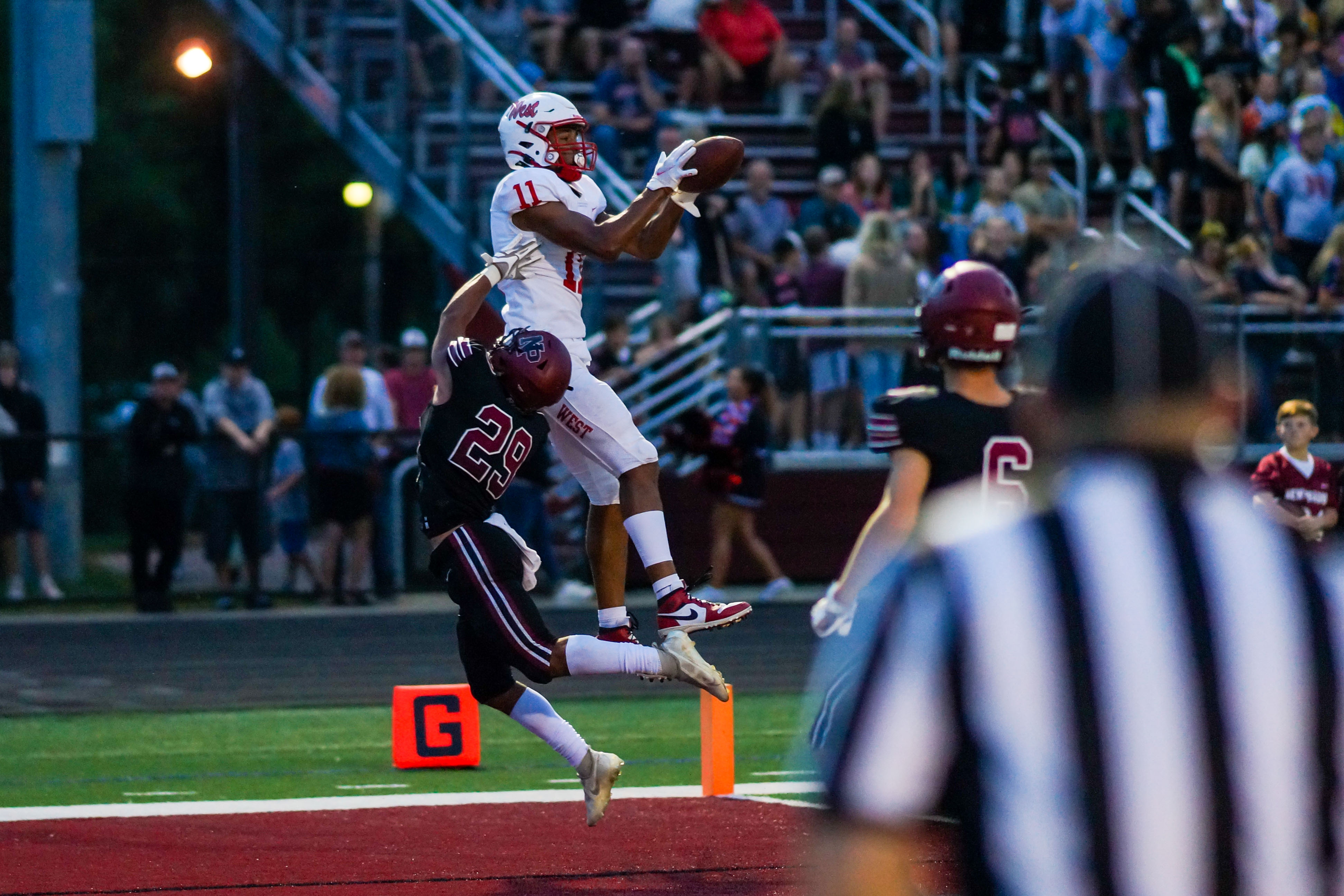 Mankato West's Mekhi Collins (11) hauls in one of his three touchdown receptions Friday night in a 41-7 victory over New Prague. Photo by Korey McDermott, SportsEngine