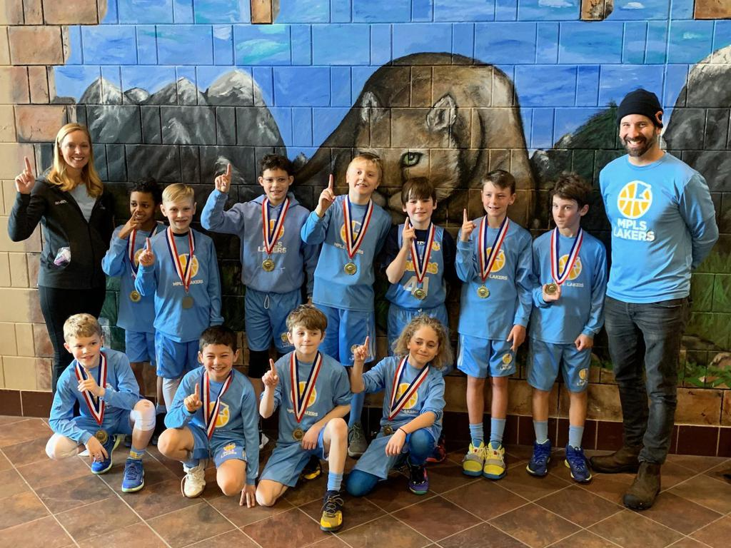 Minneapolis Lakers Boys 4th Grade Gold pose with their Medals after becoming the Champions at the Lakeville South Cougar Classic in Lakeville, MN