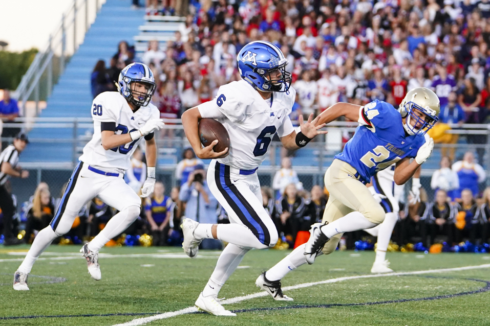 Quarterback Aaron Syverson (6) and Minnetonka stretch the lead in the first half against Wayzata on Friday. Photo by Travis Ellison, SportsEngine