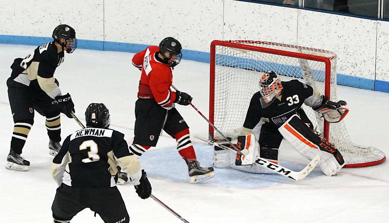 Garrett Worth redirects a shot for a goal as Team North cruised to a 7-3 win over Southwest on Sunday. Credit: Peter Odney.