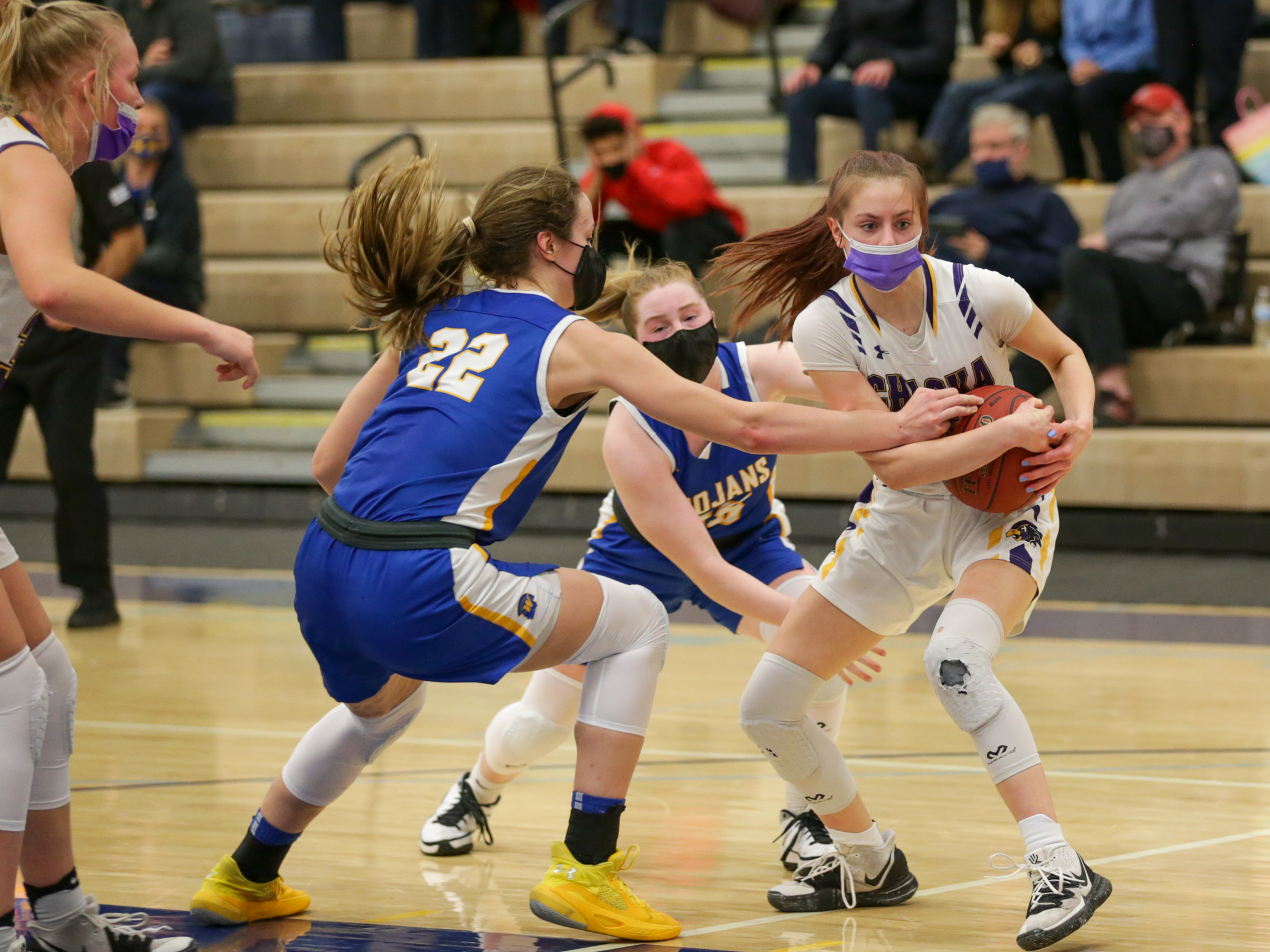 Chaska's Kelsey Willems secures a defensive rebound late in the game against Wayzata. The Hawks rallied in the second half for a 61-59 victory over the Trojans. Photo by Jeff Lawler, SportsEngine