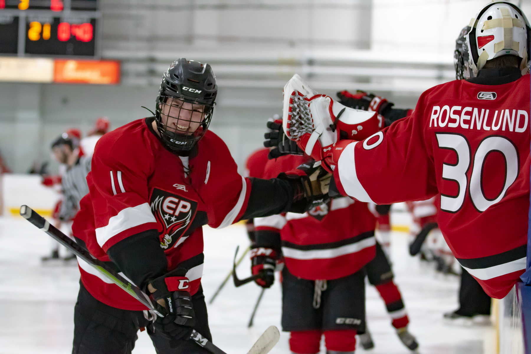Eden Prairie's Carter Batchelder celebrates with his teammates after scoring a short-handed goal in the third period to put the Eagles up 6-2. Photo by Gary Mukai, SportsEngine