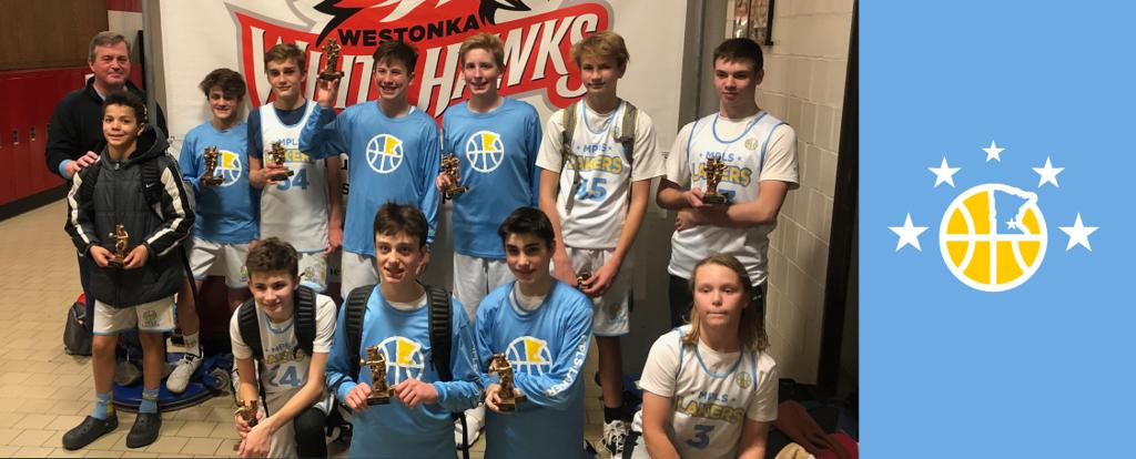 Minneapolis Lakers Youth Basketball Program Boys 8th Grade Blue pose with their Trophies after becoming the Champions at the Westonka White Hawk Classic tournament in Mound, MN
