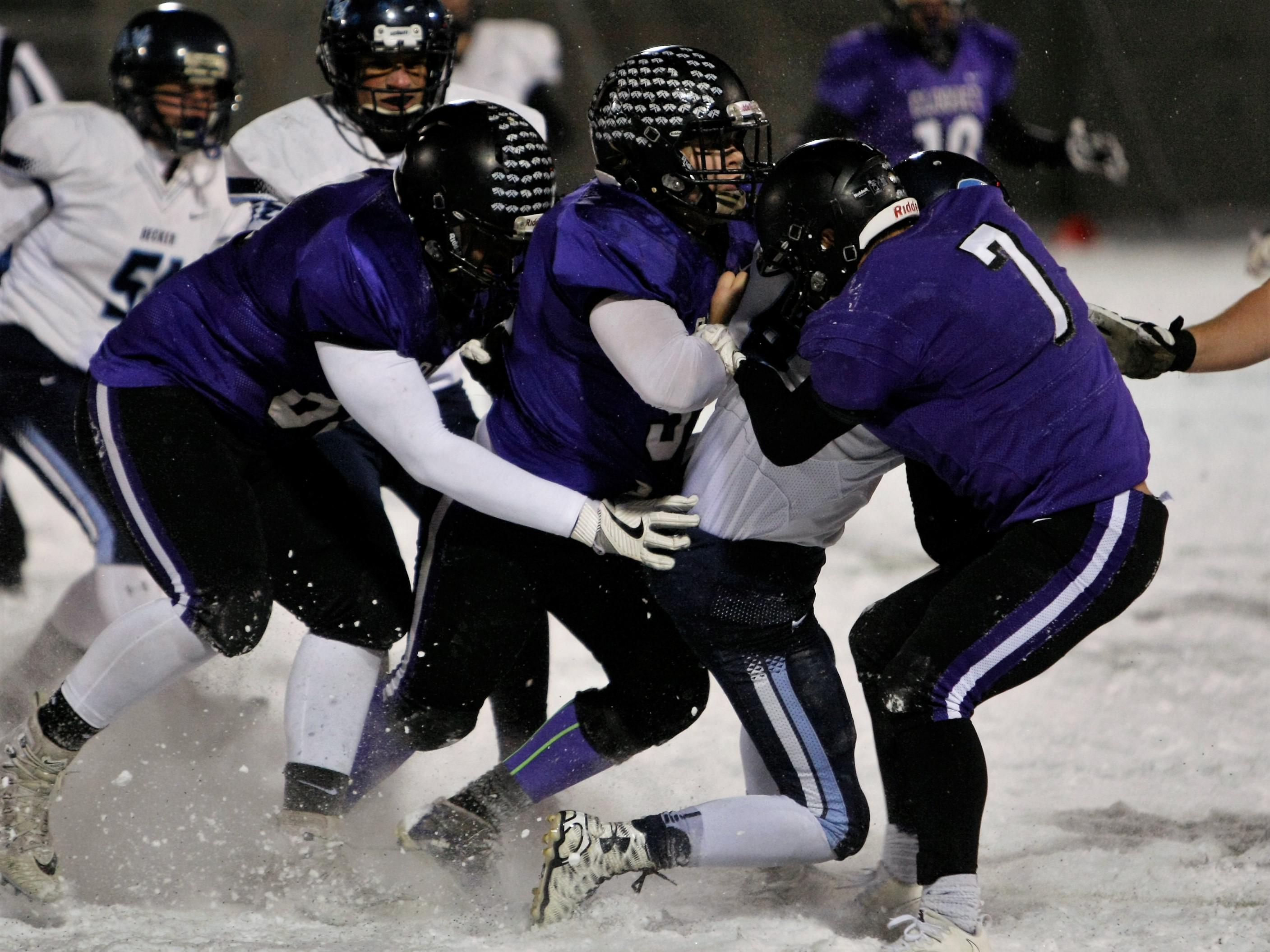 A bevy of Cloquet defenders drag a Bulldog down in their 36-21 Class 4A state quarterfinal victory at St. Cloud State University Friday. Photo by Taylor Lunemann, SportsEngine