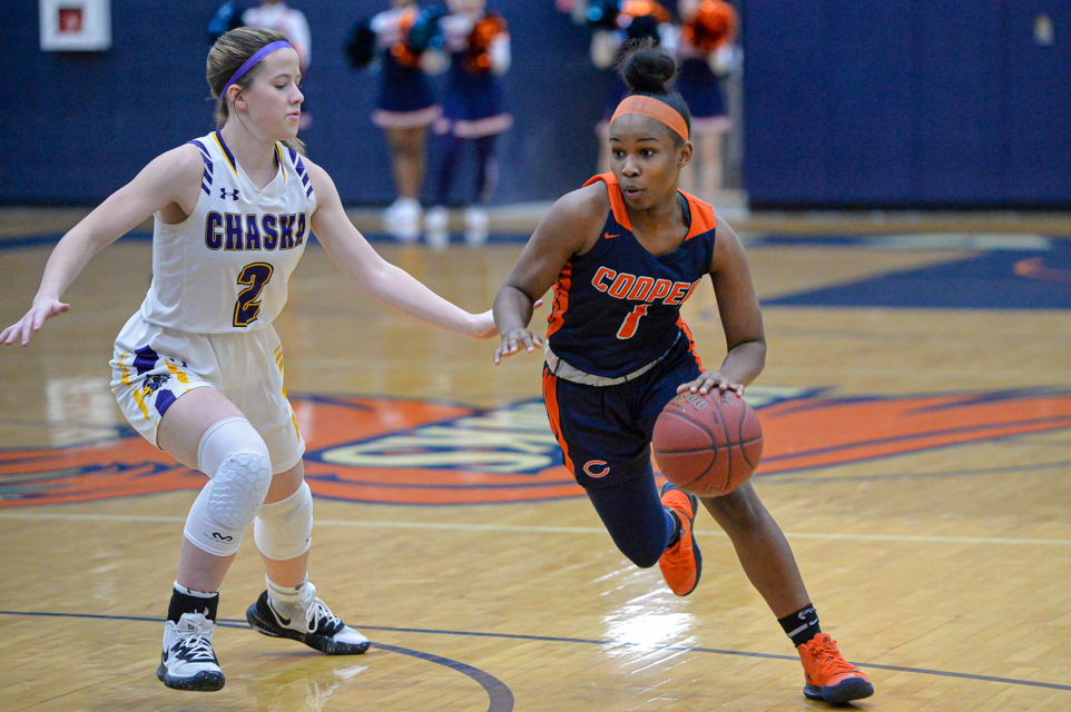 Robbinsdale Cooper's Andrea Tribble (right) put up 14 points in front of the home crowd Tuesday night in the Hawks' 64-48 loss to Chaska. Photo by Earl J. Ebensteiner, SportsEngine