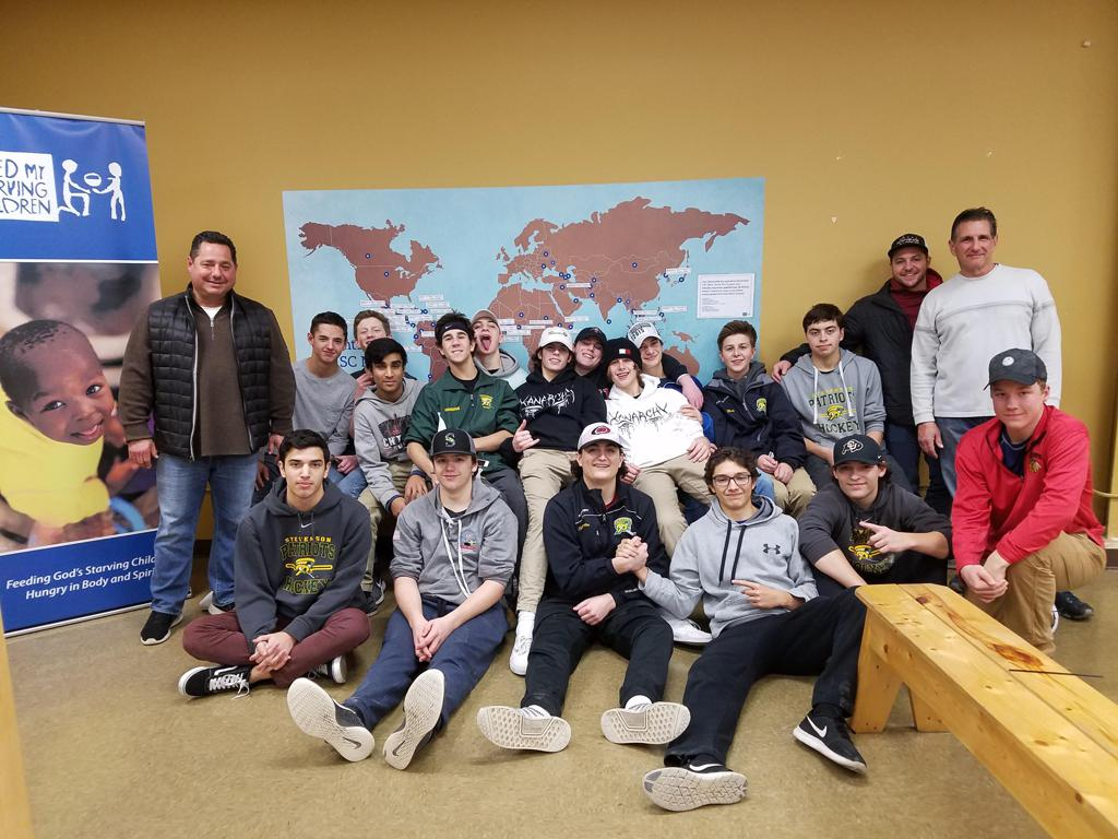 JV Gold team at the Feed My Starving Children charity event - Dec 2017