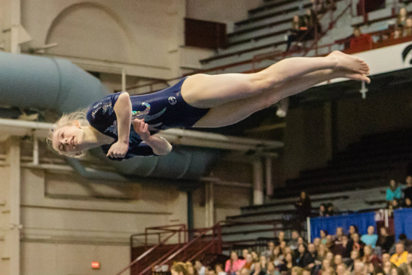 Champlin Park's Chaney Neu mid-jump during the floor exercise, in which she placed first at the 2017 Class 2A all-around championship. Photo by Matt Weber, special to the Star Tribune