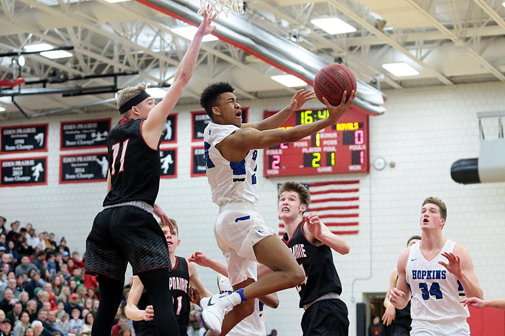 Hopkins Anthony Davis (21) takes it to the hoop past Eden Prairie defender Drake Dobbs (11). Davis led all scoring with 21 points as the Royals roll past the Eagles 84-77 in a Class 2A top four contest. Photo by Cheryl Myers, SportsEngine