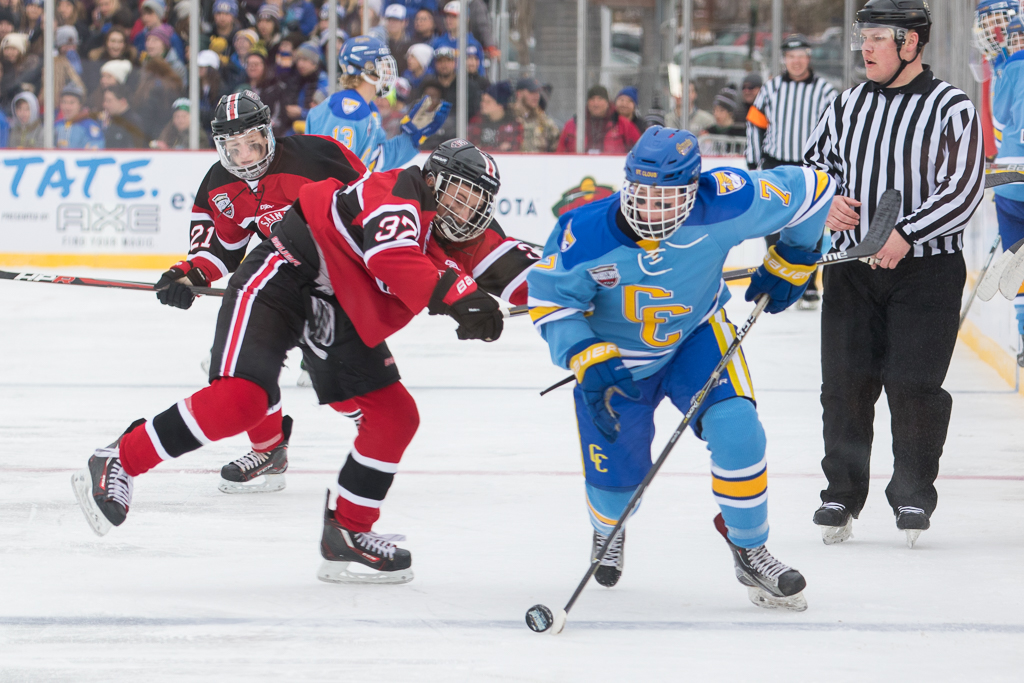 St. Cloud Cathedral's Nate Martin fights to get around St. Cloud's Luke Johnson on Hockey Day Minnesota, 2018. The Crusaders defeated St. Cloud 8-3. Photo by Jeff Lawler, SportsEngine