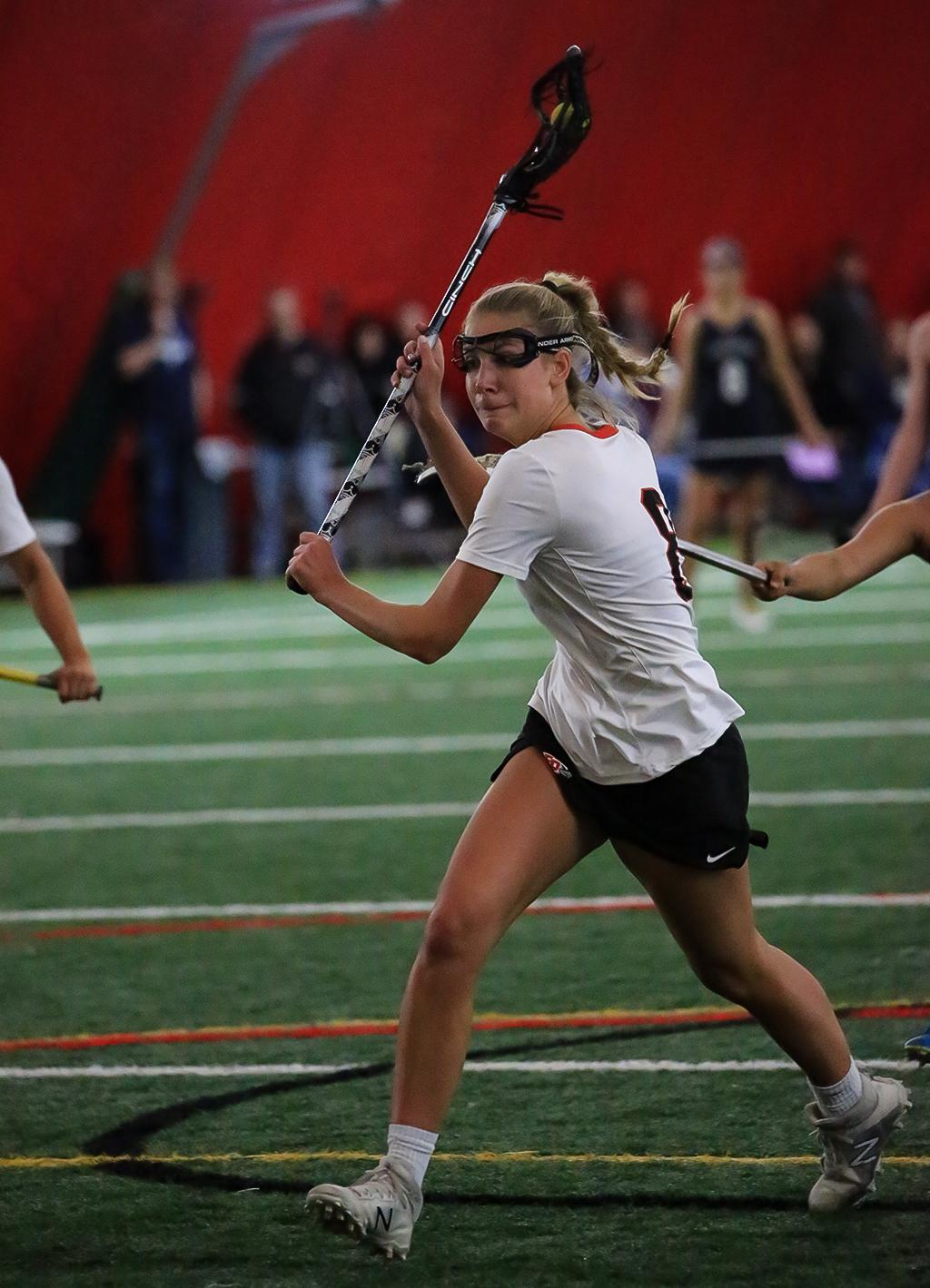 Brooke Lewis fires off a shot from close range, scoring one of her five goals for the Eagles. Eden Prairie pulled away in the second half to top Chanhassen 16-9 on Tuesday night. Photo by Cheryl Myers, SportsEngine