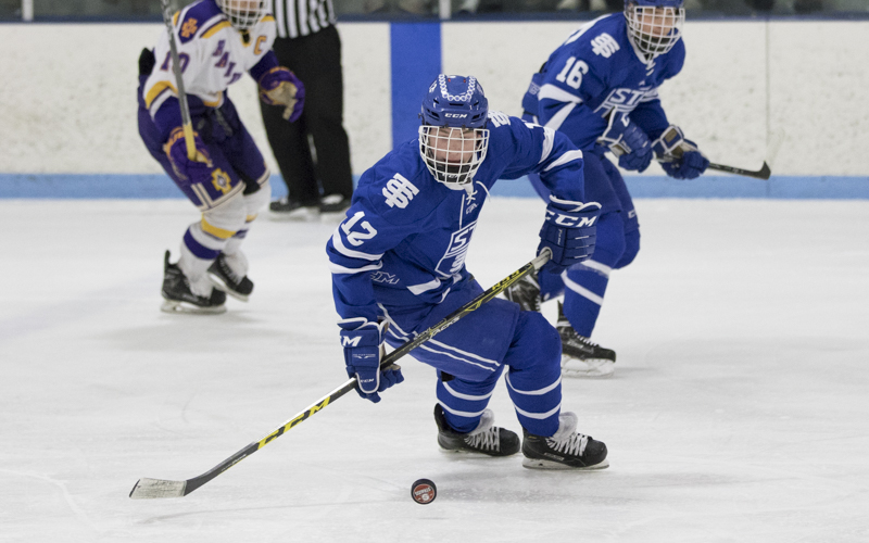 St. Thomas Academy junior Ryan O'Neill brings the puck into the offensive zone against Cretin-Derham Hall Wednesday night. The Cadets defeated the Raiders 2-0 at Highland Arena in St. Paul. Photo by Jeff Lawler, SportsEngine