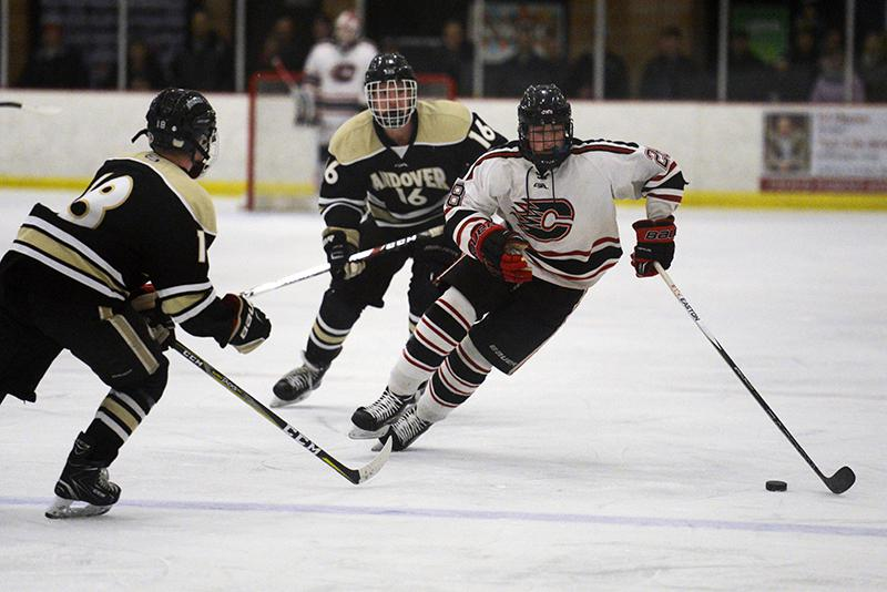 Centennial forward Joshua Hermes skates up ice against Andover. Photo by Carter Jones, SportsEngine
