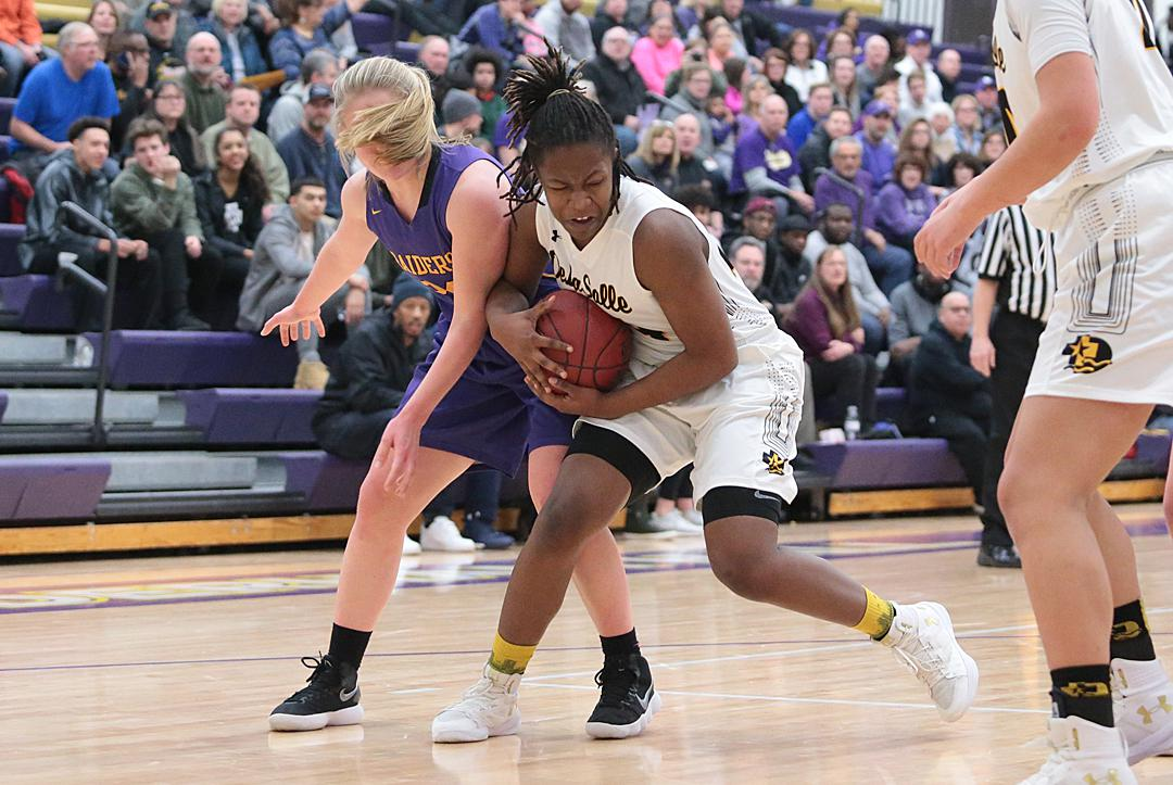 Elaina Jones (24) battles for possession before fouling out in the second half. Jones led DeLaSalle with 16 points despite limited playing time due to foul trouble. Photo by Cheryl Myers, SportsEngine
