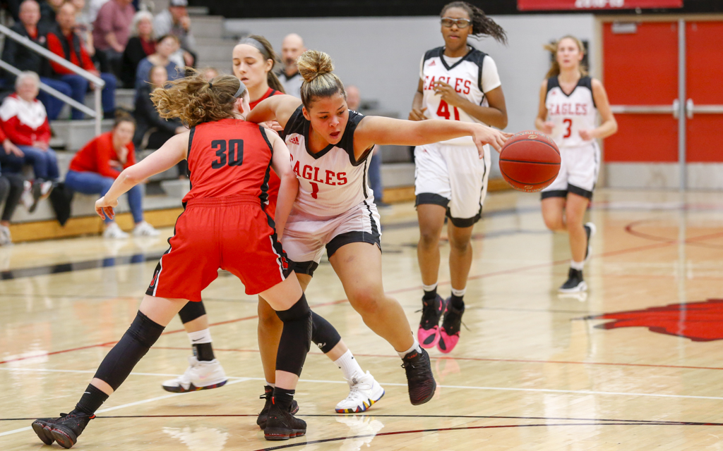 Eden Prairie's Nneka Obiazor is fouled on the way to the basket by Stillwater's Delaney Wagner.  Obiazor had 19 points in the Eagles' 78-63 loss to the Ponies. Photo by Jeff Lawler, SportsEngine