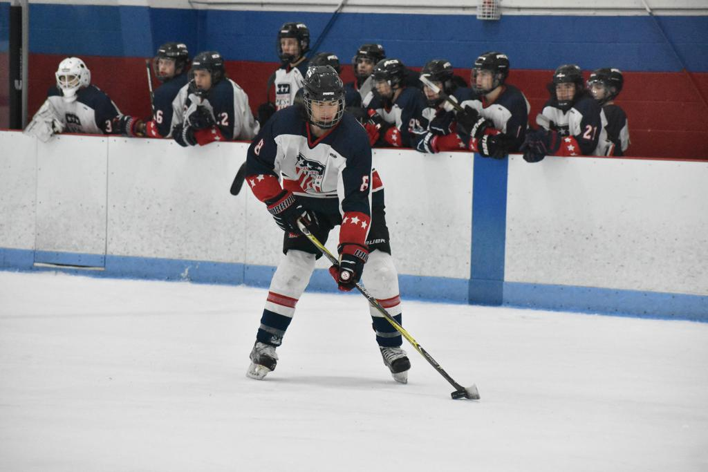16U forward Cam Croteau skates with the puck.
