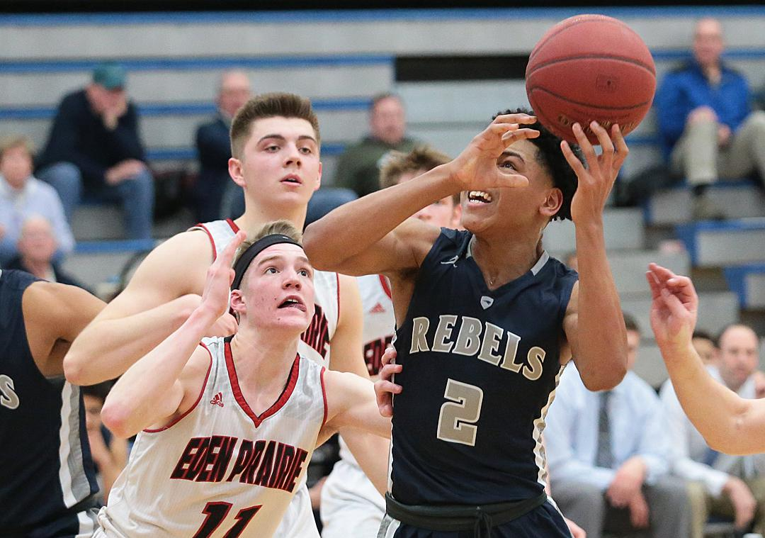 Josiah Strong (2) keeps an eye on the basket as he drives the lane. Strong led Champlin Park in scoring with 25 points steering them to a 86-83 win over Eden Prairie in a Class-4A top ten tilt. Photo by Cheryl Myers, SportsEngine