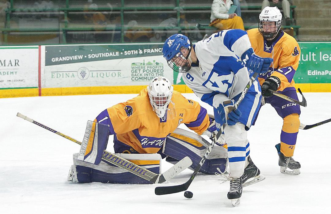 Minnetonka sophomore Bobby Brink (9) tries to control a bouncing puck in front of Chaska goalie Justin Bach. Brink scored twice in the 4-1 win advancing the Skippers to the Class 2A, Section 2 championship game. Photo by Cheryl Myers, SportsEngine