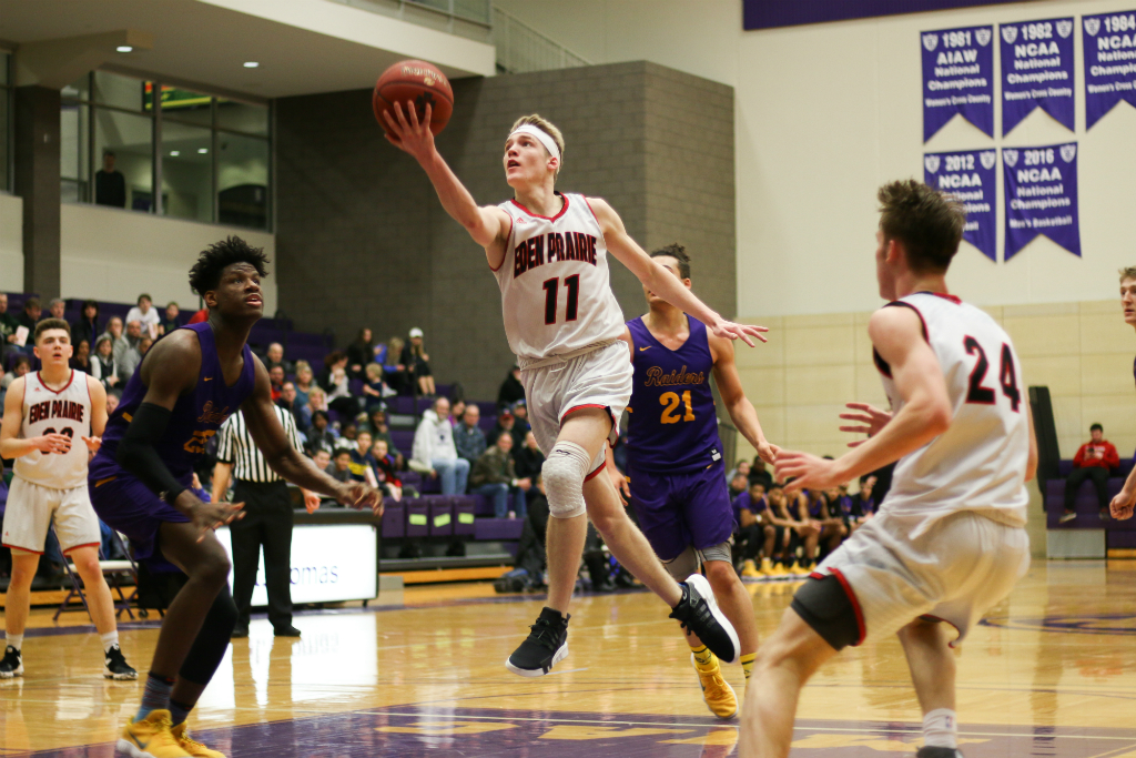 Eden Prairie's Drake Dobbs (11) sank a layup with 2 seconds left to lift the No. 14-4A Eagles to a 65-63 upset over No. 1-4A Cretin-Derham Hall Wednesday night at Schoenecker Arena at the University of St. Thomas. Photo by Trevor Squire, SportsEngine
