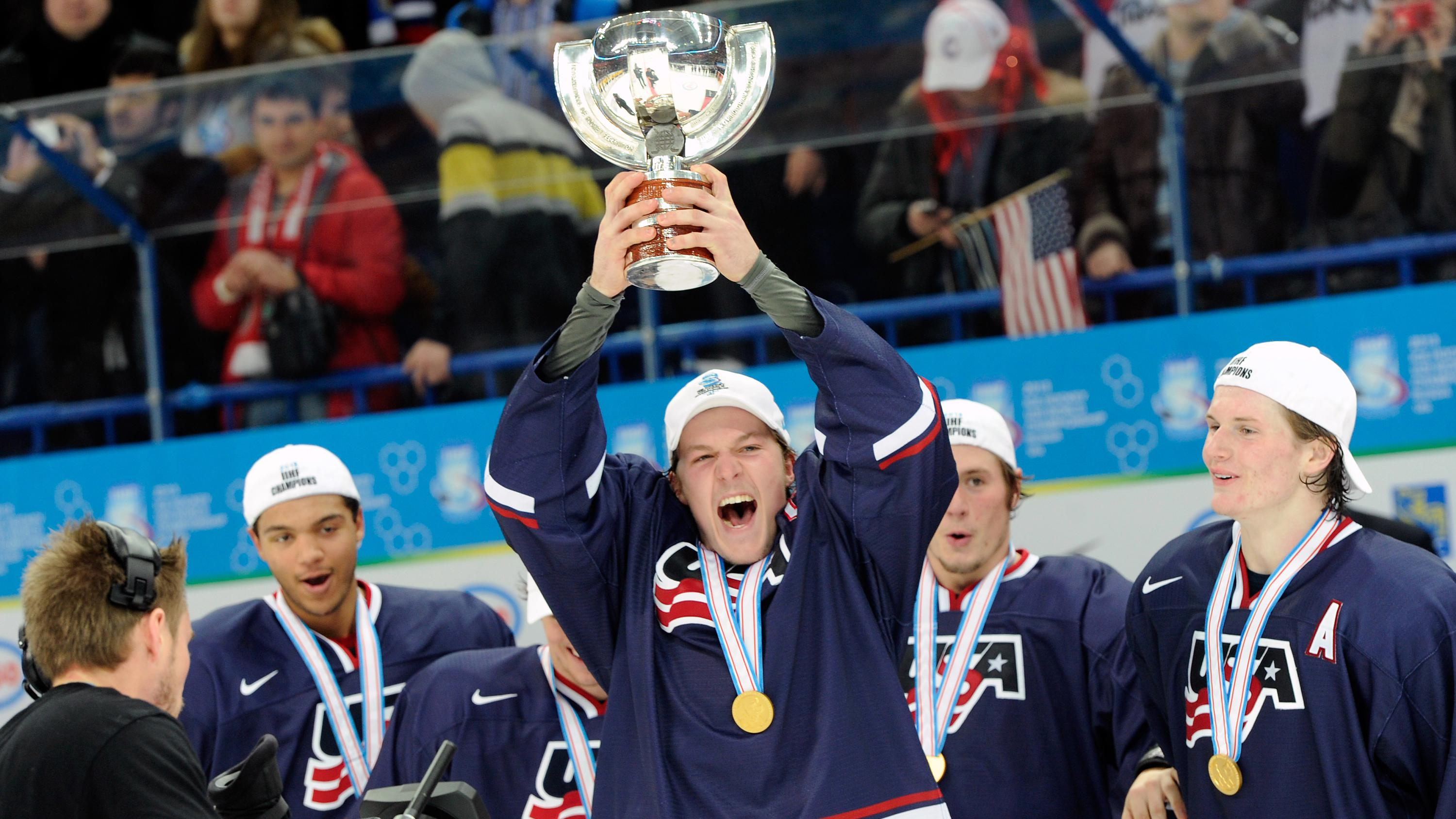 McCabe with the World Junior trophy in 2013