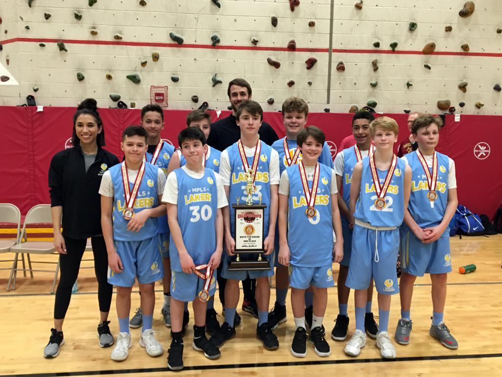 Boys 7th Grade Gold pose with medals and trophy