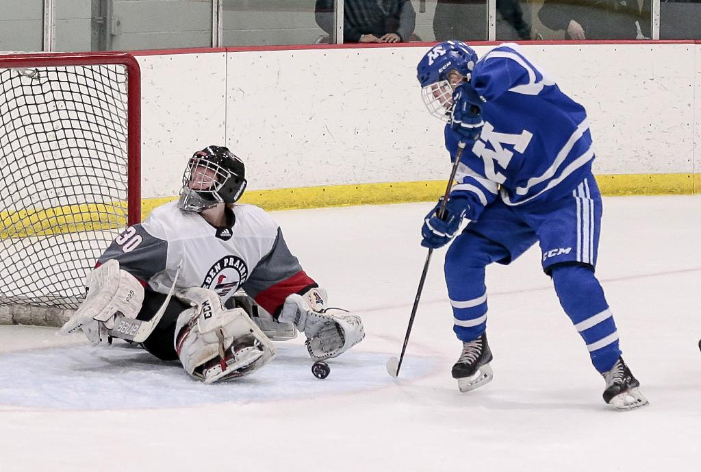 Minnetonka's Kylie Melz picks up her own rebound and scores with just 44 second left in the game. Melz's two goals help pushed the Skippers to a 4-3 win over the Eagles in the Mid-Winter Meltdown on Saturday night. Photo by Cheryl A. Myers, SportsEngine