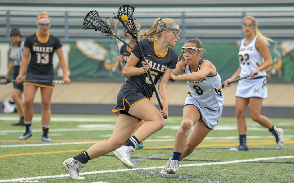 Apple Valley's Molly Moynihan drives the net during the first half of the Section 6 final against Prior Lake. The Eagles advanced to next week's state tournament with a 13-12 victory over the Lakers. Photo by Jeff Lawler, SportsEngine