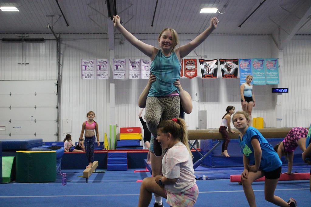 Cheerleaders stunting at Jam Hops
