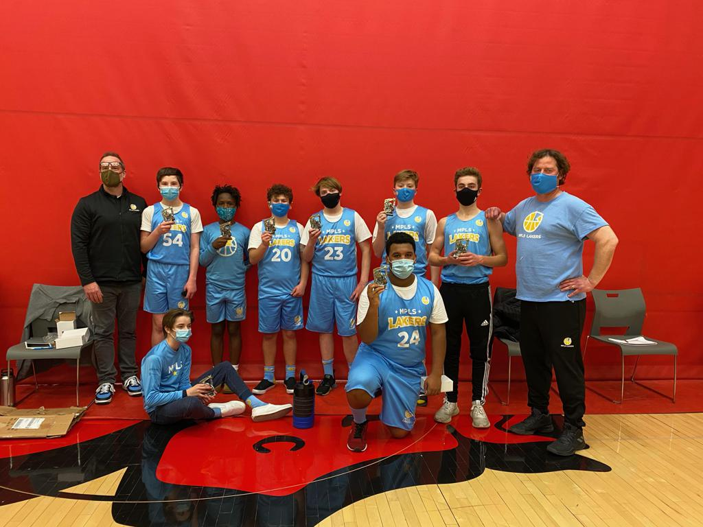 Mpls Lakers Youth Traveling Basketball Program Inc Boys 8th Grade White pose with their trophies after placing 2nd at the Woodbury Classic tournament in Woodbury, MN