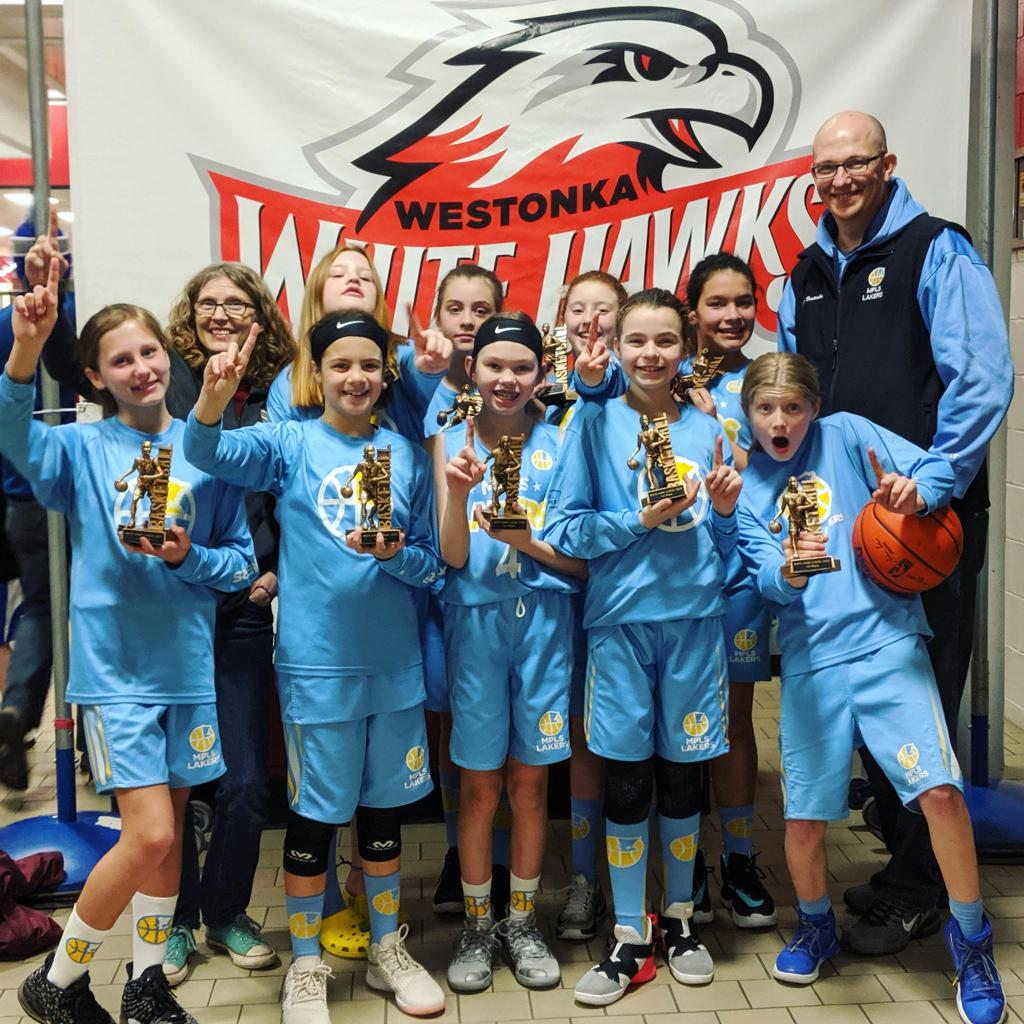 Minneapolis Lakers Youth Basketball Program Boys 6th Grade Gold pose with their Trophies after becoming the Champions at the Westonka White Hawk Classic tournament in Mound, MN